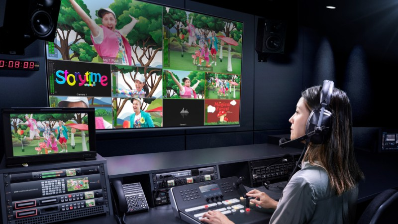 Woman using Blackmagic 4k live switcher package