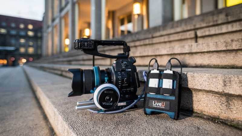 LiveU Solo connected to camera on steps to building