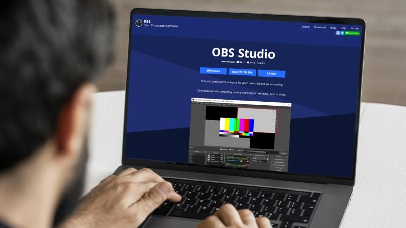 Man using OBS Studio on a laptop